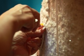 A wedding dress being altered